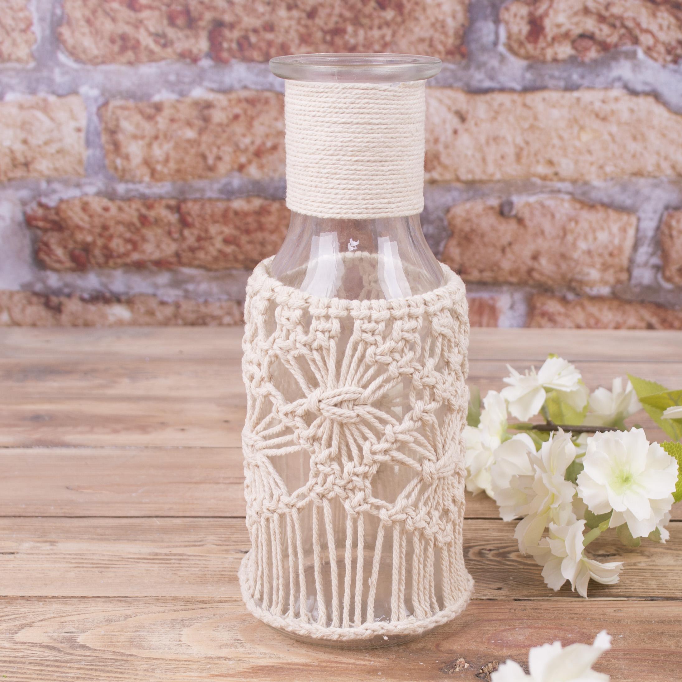Скляна пляшка з мереживом